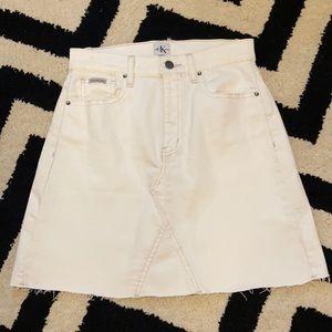 Calvin Klein white high raw hem mini jean skirt